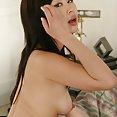 Chinese porn starlet shows off with a mouth full of cumshots - image