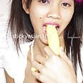 Dreamy Thai girl Cherry gets sticky in big photo set - image